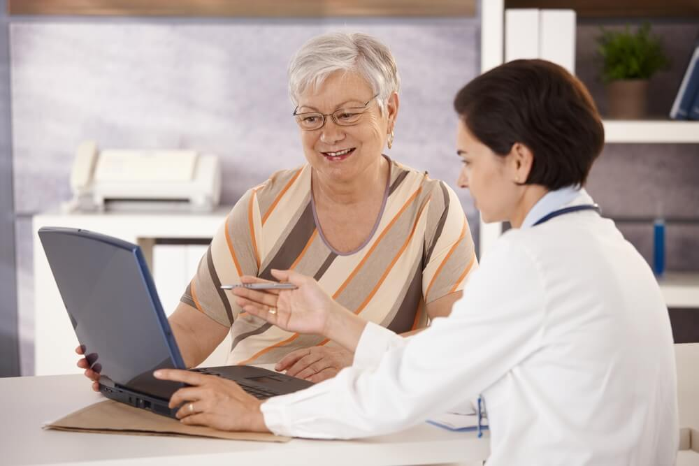 Doctor Explaining Results to Senior Patient in Office