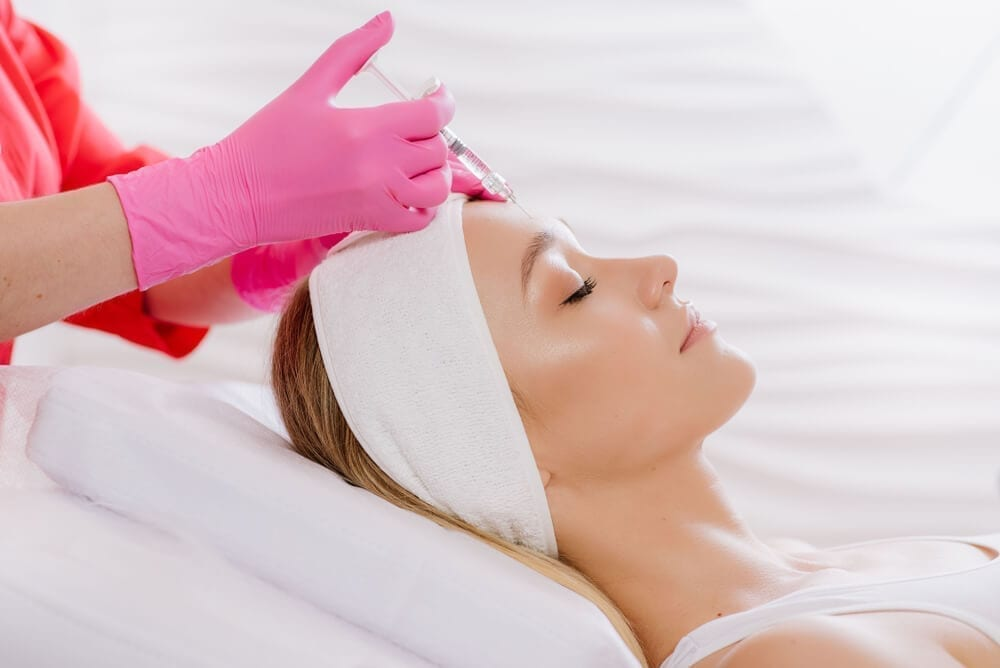Introduction Of Filler Of Hyaluronic Acid On Woman In Spa Center