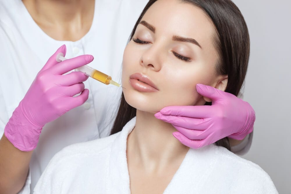 Cosmetologist Does PRP Therapy on the Face of a Beautiful Woman in a Beauty Salon