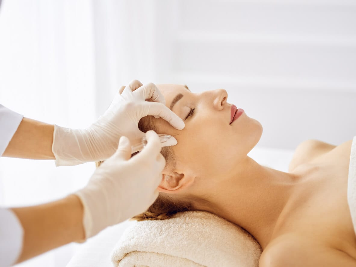 Beautiful Woman Receiving Beauty Injections With Closed Eyes